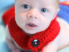 newborn with superman cape photograph